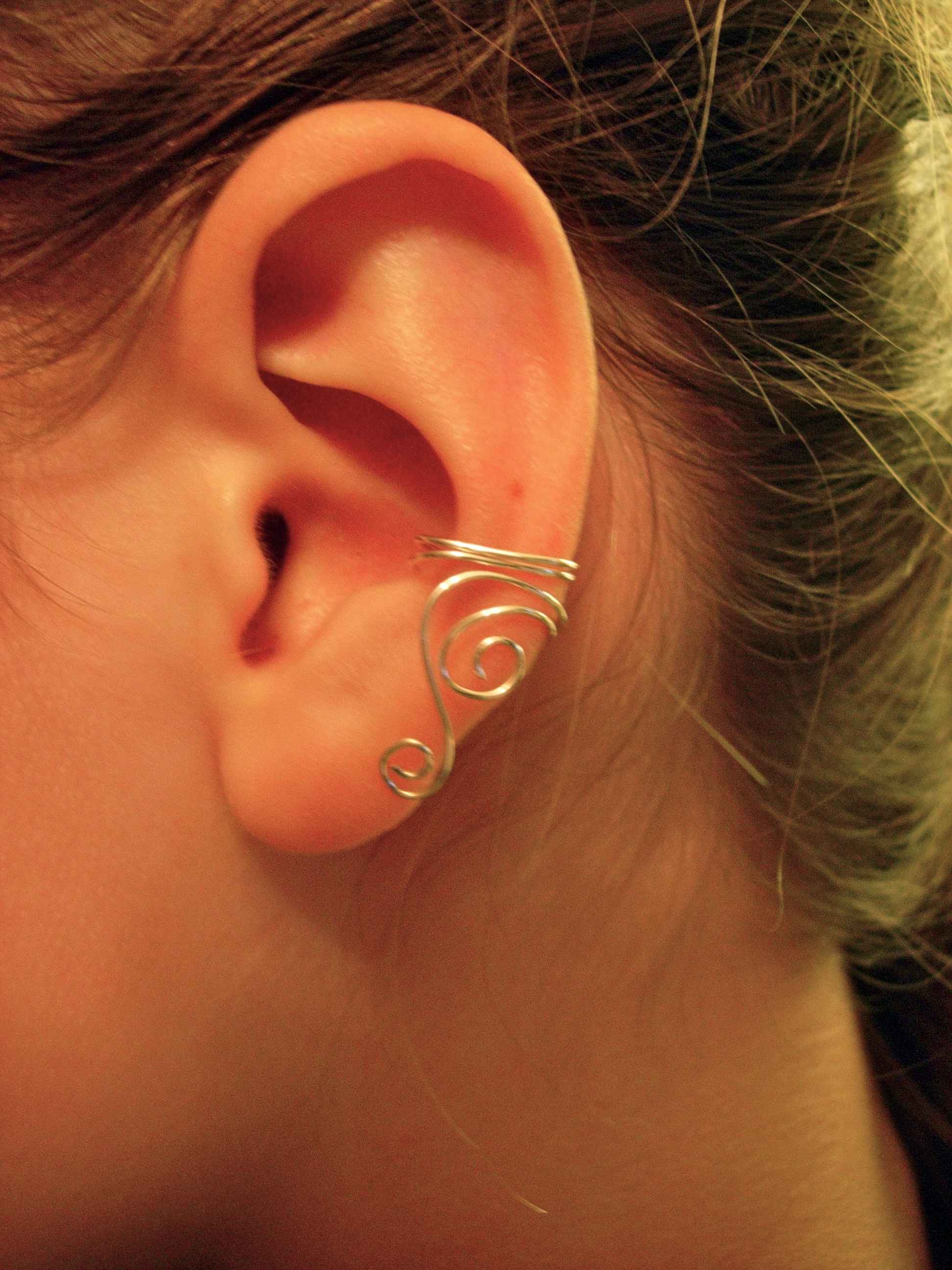 Single silver plated ear cuff with swirls on luulla for Simple single